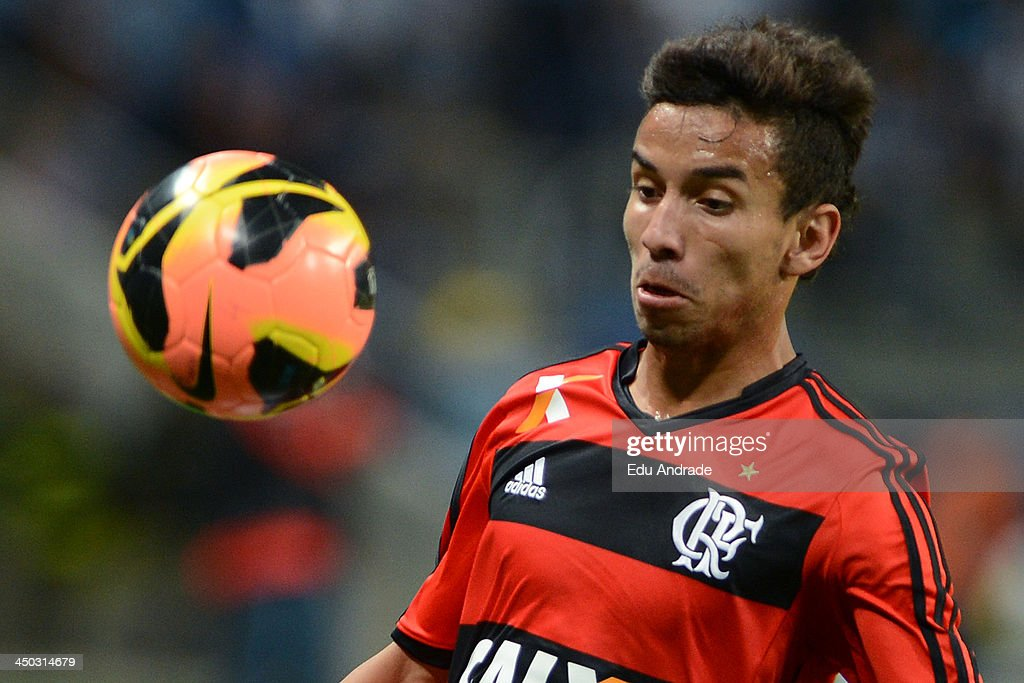 Rafinha of Flamengo runs for the ball during the match between Gremio and Flamengo for the Brazilian Series A 2013 at Arena Gremio Stadium on November 17, 2013, in Porto Alegre, Brazil.