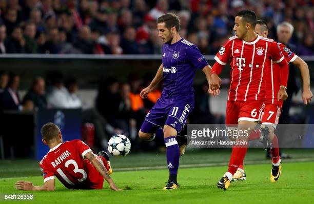 Rafinha of Muenchen and Alexandru Chipciu of Anderlecht battle for the ball during the UEFA Champions League group B match between Bayern Muenchen...