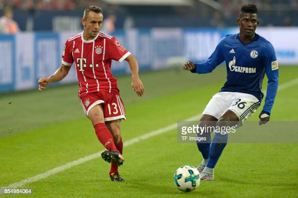Rafinha of Muenchen and Breel Embolo of Schalke battle for the ball during the Bundesliga match between FC Schalke 04 and FC Bayern Muenchen at...