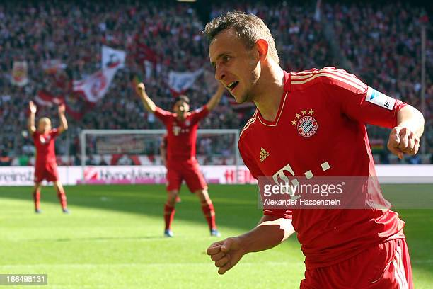 Rafinha of Muenchen celebrates scoring the 3rd team goal with his team mates Anatoliy Tymoshchuk and Claudio Pizorro during the Bundesliga match...