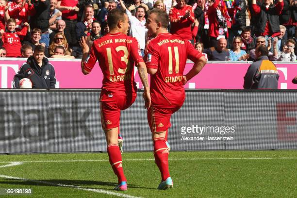 Rafinha of Muenchen celebrates scoring the 3rd team goal with his team mate Xherdan Shaqiri during the Bundesliga match between FC Bayern Muenchen...