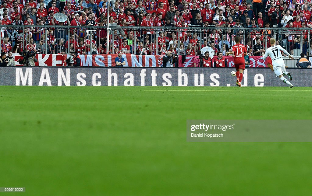 Rafinha of Muenchen (L) is challenged by Oscar Wendt of Moenchengladbach during the Bundesliga match between FC Bayern Muenchen and Borussia Moenchengladbach at Allianz Arena on April 30, 2016 in Munich, Germany.
