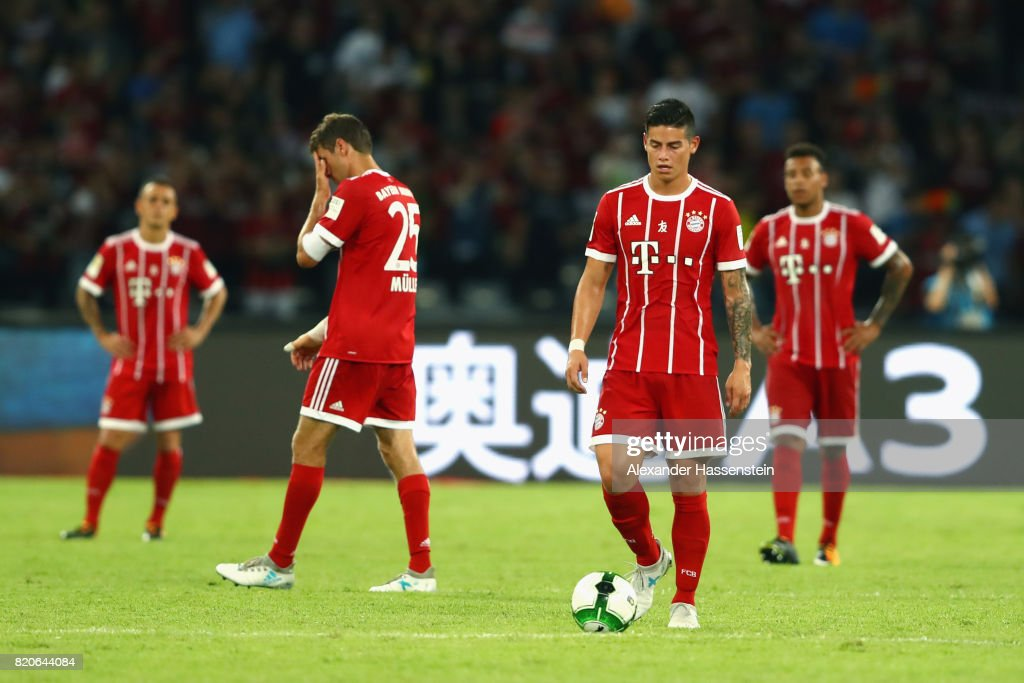 Rafinha of Muenchen reacts with his team mates Thomas Mueller, James Rodriguez and Corentin Tolisso after receiving teh 4th goal during the International Champions Cup Shenzen 2017 match between Bayern Muenchen and AC Milan at on July 22, 2017 in Shenzhen, China.