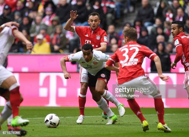 Rafinha of Munich and Robin Quaison of Mainz vie for the ball during the Bundesliga soccer match between FC Bayern Munich and Mainz 05 at the Allianz...