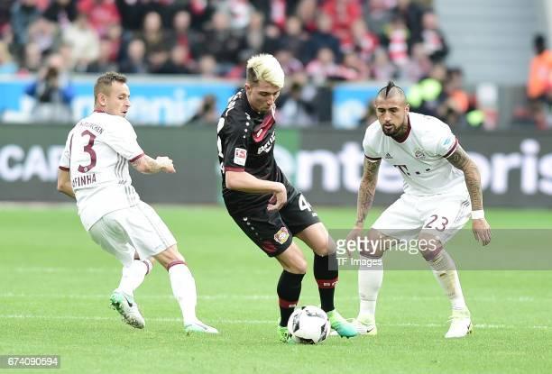 Rafinha of Munich Kevin Kampl of Leverkusen Arturo Vidal of Munich battle for the ball during the Bundesliga match between Bayer 04 Leverkusen and...