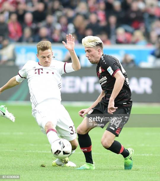 Rafinha of Munich Kevin Kampl of Leverkusen battle for the ball during the Bundesliga match between Bayer 04 Leverkusen and Bayern Muenchen at...