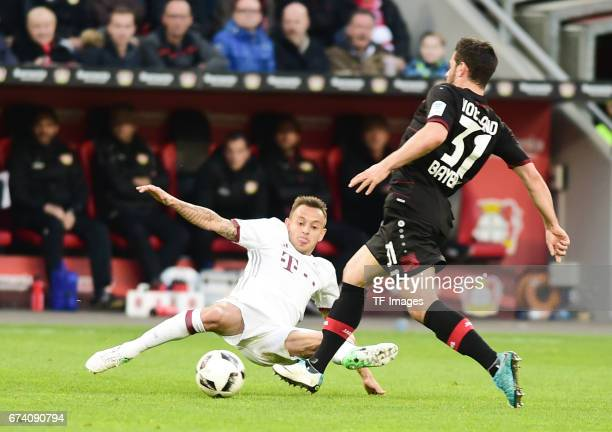 Rafinha of Munich Kevin Volland of Leverkusen battle for the ball during the Bundesliga match between Bayer 04 Leverkusen and Bayern Muenchen at...