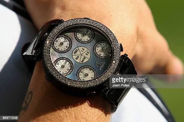 Rafinha of Schalke wears a Jacob Co watch during the Bundesliga match between FC Schalke 04 and Karlsruher SC at the VeltinsArena on April 11 2009 in...