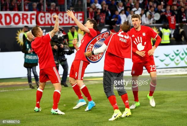 Rafinha Robert Lewandowski Arturo Vidal and Thomas Mueller of Muenchen celebrate after the Bundesliga match between VfL Wolfsburg and Bayern Muenchen...