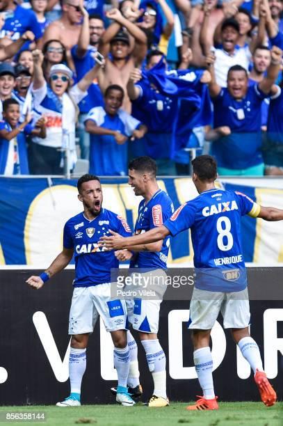Rafinha Thiago Neves and Henrique of Cruzeiro celebrates a scored goal against Corinthians during a match between Cruzeiro and Corinthians as part of...