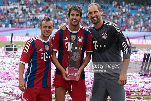 RafinhaTom Stark and Javi Martinez of Munich celebrates with the trophy after the Telekom Cup 2014 Finale match between FC Bayern Muenchen and...