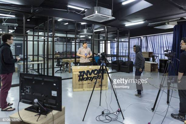 Rafizi Ramli vice president of the People's Justice Party center prepares for a Facebook Inc live video stream at Invoke's office in Kuala Lumpur...