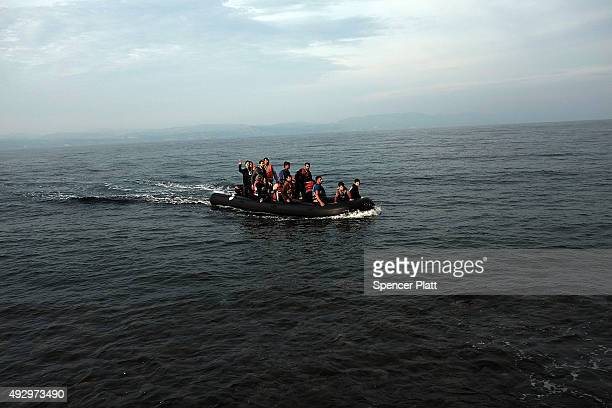 A raft arrives onto the island of Lesbos on October 16 2015 in Sikaminias Greece Dozens of rafts and boats are still making the journey daily as...