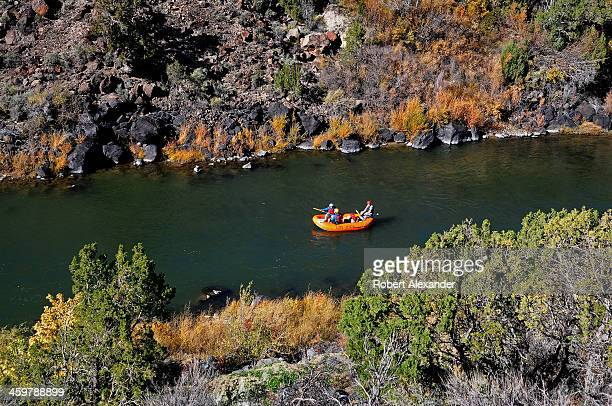 Rafters float along a calm stretch of the Rio Grande River near Taos New Mexico The stretch of river and the gorge it carved into the desert...