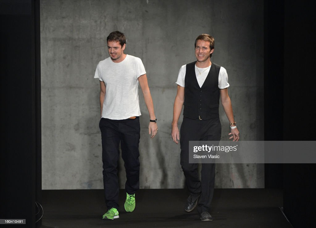 Rag & Bone designers Marcus Wainwright (L) and David Neville walk the runway during the Rag & Bone Men's collection fall 2013 fashion show on January 30, 2013 in New York City.