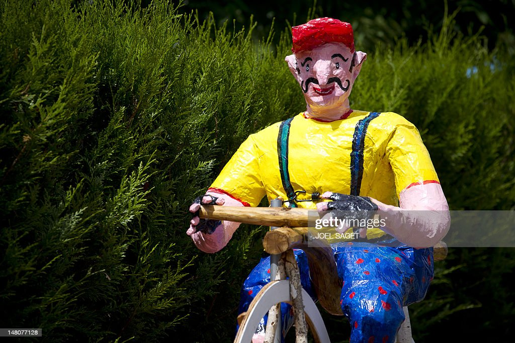 A rag doll decoration representing a cyclist is pictured during the 41,5 km individual time-trial and ninth stage of the 2012 Tour de France cycling race starting in Arc-et-Senans and finishing in Besancon, eastern France, on July 9, 2012.