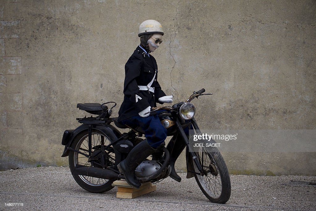 A rag doll representing a 60's police motobiker is pictured during the 41,5 km individual time-trial and ninth stage of the 2012 Tour de France cycling race starting in Arc-et-Senans and finishing in Besancon, eastern France, on July 9, 2012. AFP PHOTO / JOEL SAGET