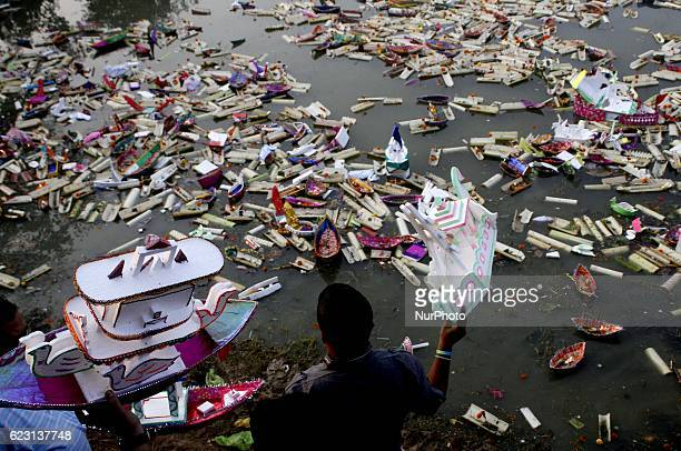Rag picker boys look in the water of holy pond Bindu Sagar as they are searching coins and re usable items from the fancy boats as devotees sail it...