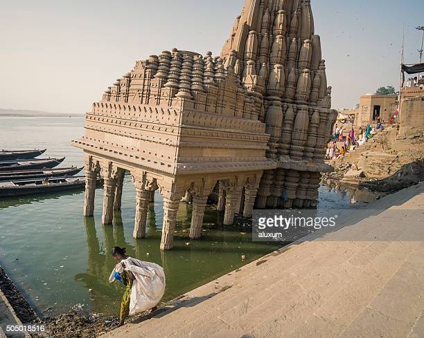 Rag picker in Scindia ghat Varanasi India