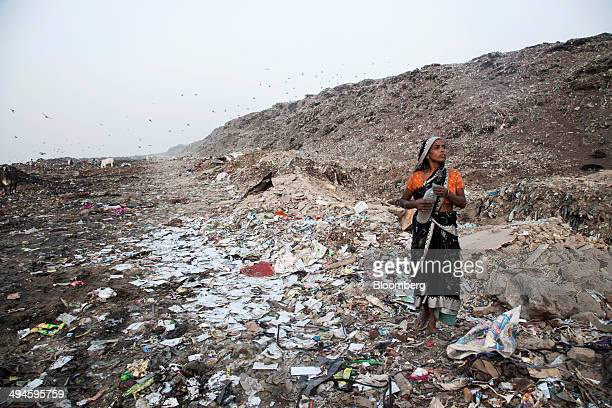 A rag picker takes a break from sorting through garbage at the Ghazipur landfill site in the east of New Delhi India on Friday May 30 2014 New Delhi...