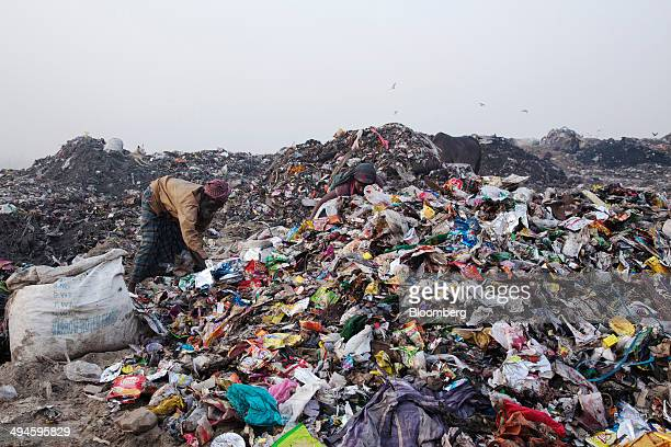 Rag pickers sort through garbage picking out recyclable materials to sell at the Ghazipur landfill site in the east of New Delhi India on Friday May...