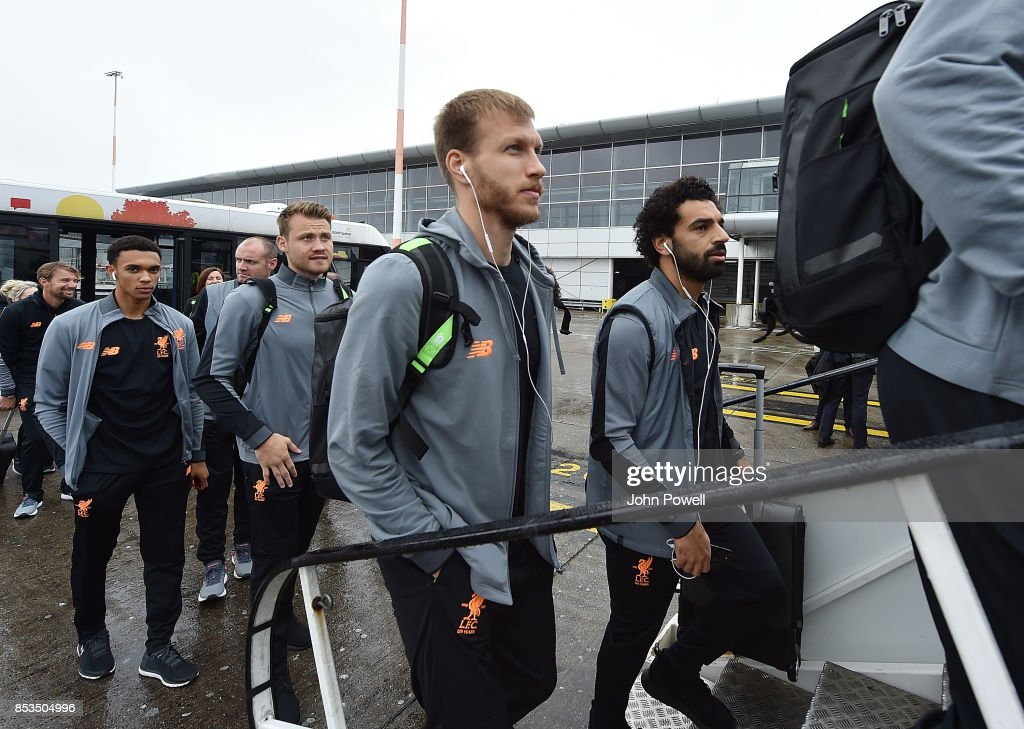 Raganr Klavan and Mohamed Salah of Liverpool boarding the plane at John Lennon Airport on September 25, 2017 in Liverpool, England.