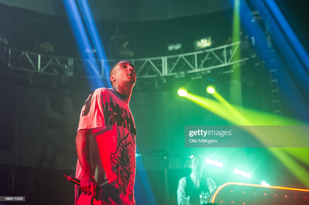 Rage and Will 'Status' Kennard of Chase Status perform on stage during the opening night of the Brand New Machine November 2013 UK Arena Tour at...