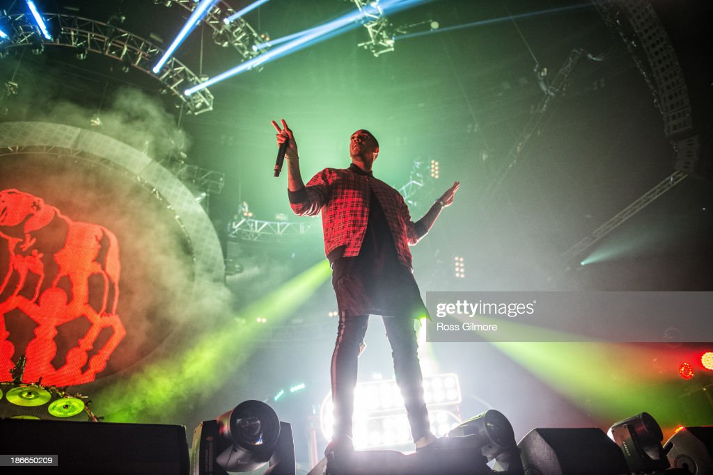 Rage of Chase Status performs on stage at The SSE Hydro on November 2 2013 in Glasgow United Kingdom