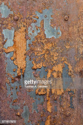 Ragged and rusty sheet metal plate