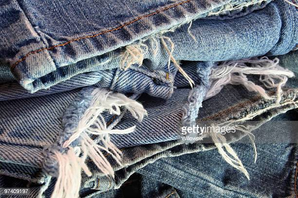 Ragged Old Blue Jeans in a Messy Pile