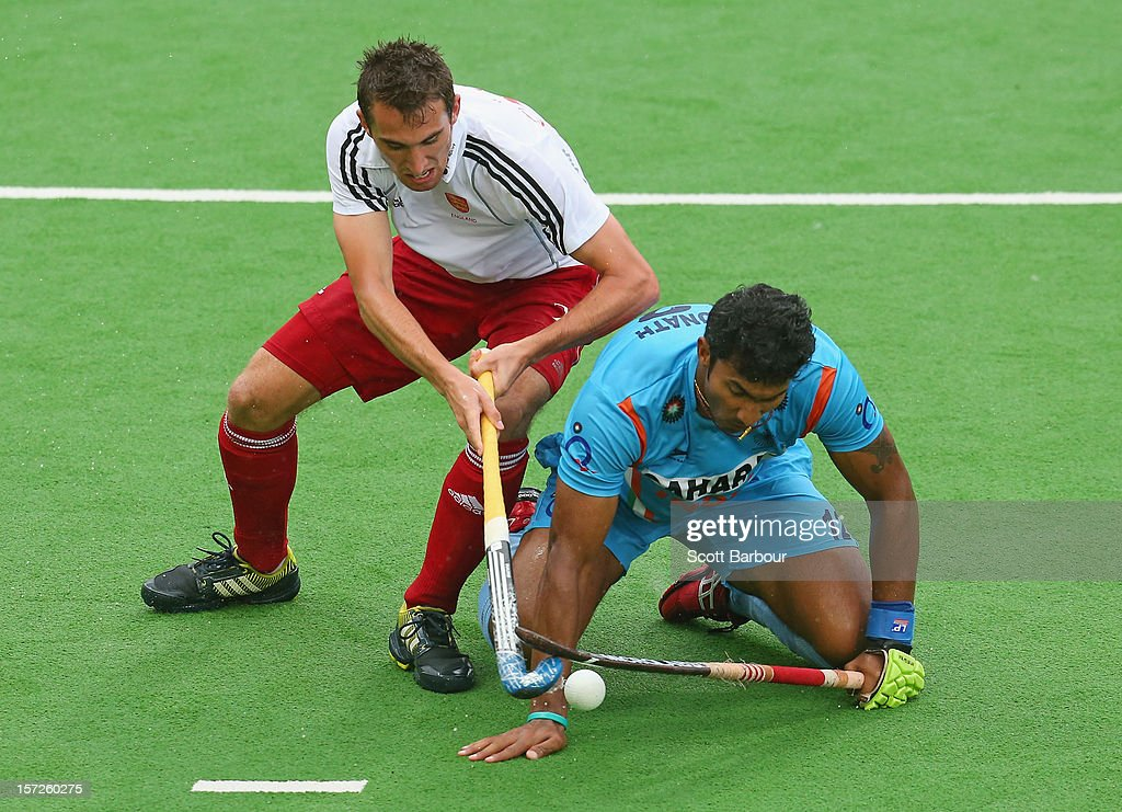 V.R. Raghunath of India and David Condon of England compete for the ball during the match between England and India on day one of the Champions Trophy on December 1, 2012 in Melbourne, Australia.