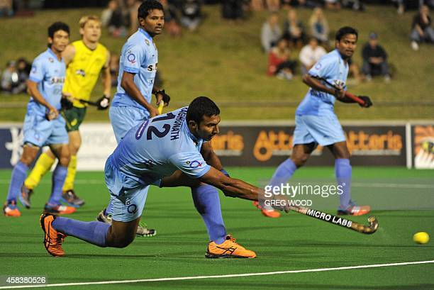 Raghunath Vokkaliga from India passes the ball during the first match of the four match field hockey Test series against Australia in Perth on...