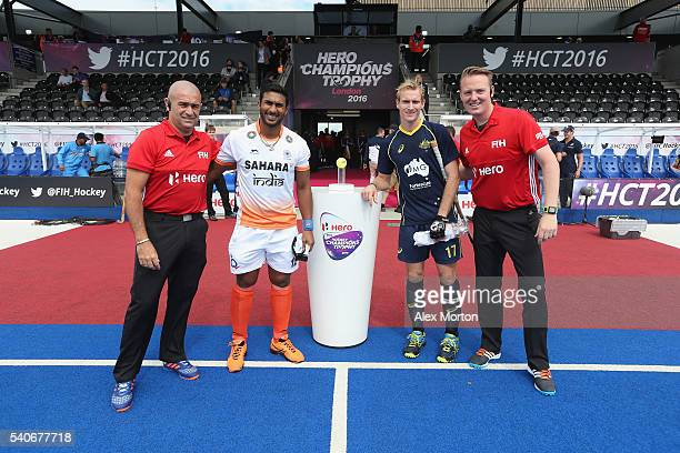 Raghunath Vokkaliga of India and Aran Zalewski with the officials prior to the FIH Mens Hero Hockey Champions Trophy match between Australia and...