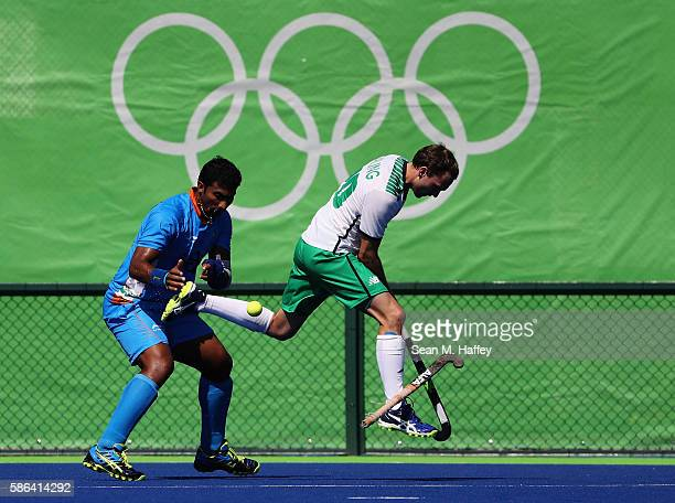 Raghunath Vokkaliga of India collides with Michael Darling of Ireland during a Pool B match between Ireland and India on Day 1 of the Rio 2016...