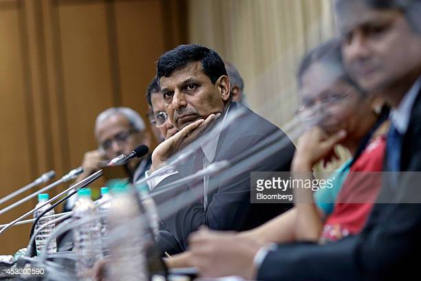 Raghuram Rajan governor of the Reserve Bank of India center listens during a news conference at the central bank's headquarters in Mumbai India on...
