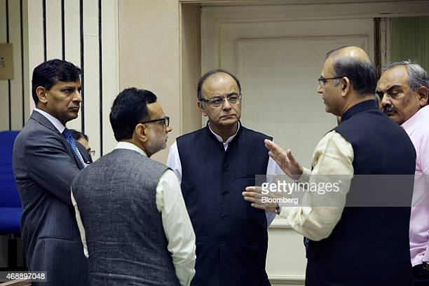 Raghuram Rajan governor of the Reserve Bank of India left and Arun Jaitley India's finance minister center listen as Jayant Sinha minister of state...