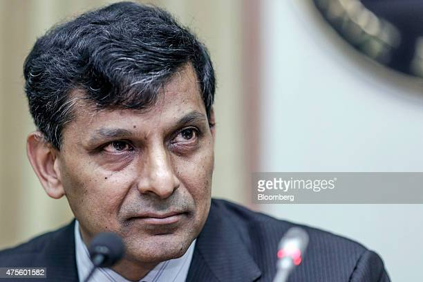 Raghuram Rajan governor of the Reserve Bank of India listens during a news conference at the central bank's headquarters in Mumbai India on Tuesday...
