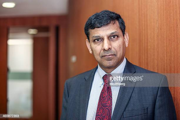 Raghuram Rajan governor of the Reserve Bank of India poses for a photograph following a Bloomberg Television India interview in Mumbai India on...