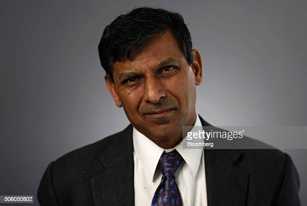 Raghuram Rajan governor of the Reserve Bank of India poses for a photograph following a Bloomberg Television interview in Davos Switzerland on...