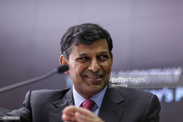 Raghuram Rajan governor of the Reserve Bank of India smiles during a news conference in Mumbai India on Tuesday Aug 4 2015 Rajan kept interest rates...