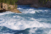 Big waves form on the Kootenai river swollen with mountain snow runoff.  Montana.  Slow shutter speed.