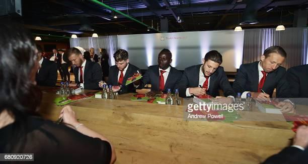 Ragnar Klavan Alberto Moreno Sadio Mane Adam Lallana and Lucas Leiva of Liverpool sign autographs during the Liverpool FC Player Awards at Anfield on...