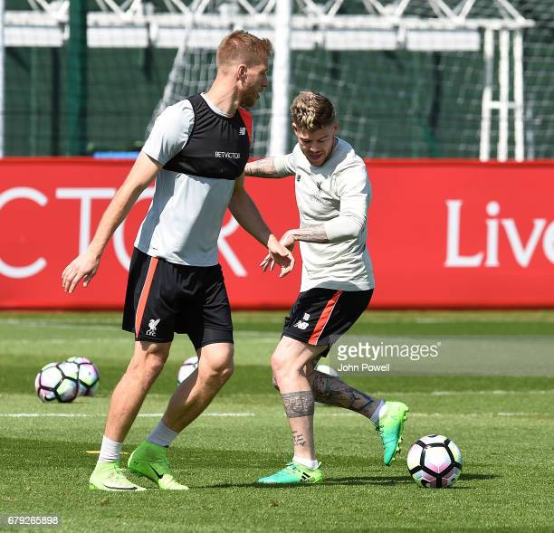 Ragnar Klavan and Alberto Moreno of Liverpool during a training session at Melwood Training Ground on May 5 2017 in Liverpool England