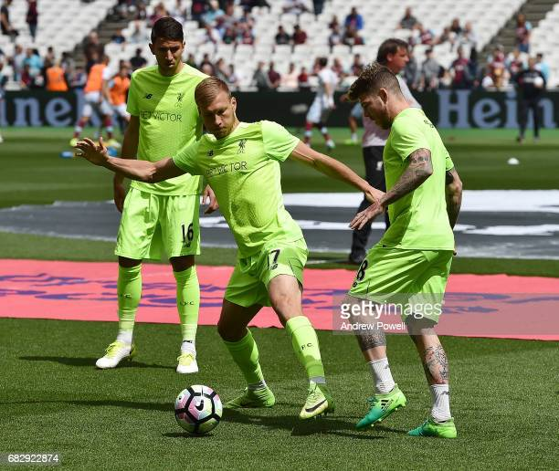 Ragnar Klavan and Alberto Moreno of Liverpool warm up before the Premier League match between West Ham United and Liverpool at London Stadium on May...