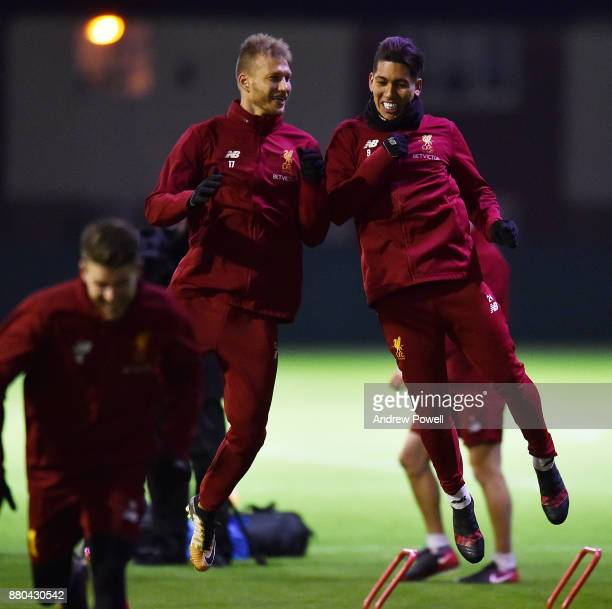 Ragnar Klavan and Roberto Firmino of Liverpool during a training session at Melwood Training Ground on November 27 2017 in Liverpool England