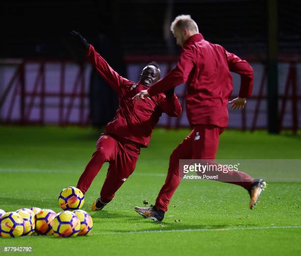 Ragnar Klavan and Sadio Mane of Liverpool during a training session at Melwood Training Ground on November 23 2017 in Liverpool England