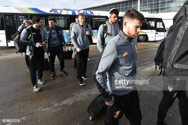 Ragnar Klavan Joe Gomez Alberto Moreno and Dominic Solanke of Liverpool before departing for the group E Champions League match between Sevilla and...