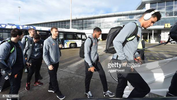 Ragnar Klavan Joe Gomez and Dominic Solanke of Liverpool before departing for the group E Champions League match between Sevilla and Liverpool at...