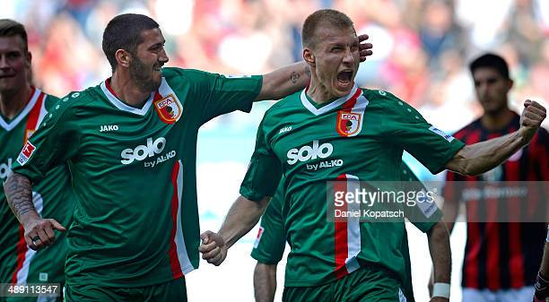 Ragnar Klavan of Augsburg celebrates his team's first goal with Sascha Moelders of Augsburg during the Bundesliga match between FC Augsburg and...