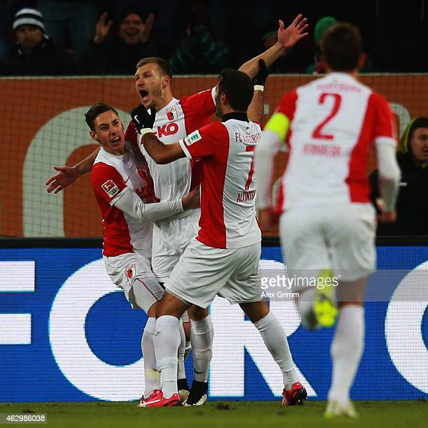 Ragnar Klavan of Augsburg celebrates his team's first goal with team mates Dominik Kohr Halil Altintop and Paul Verhaegh during the Bundesliga match...